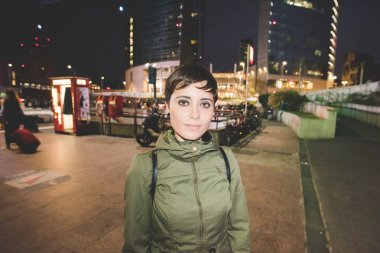 woman looking serious in city night