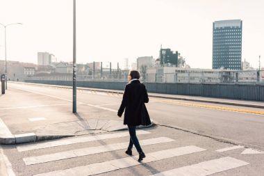 woman listening music walking outdoor