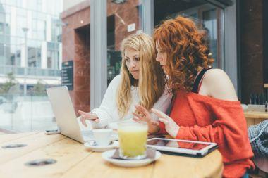 women friends using computer