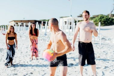 friends playing with beach ball