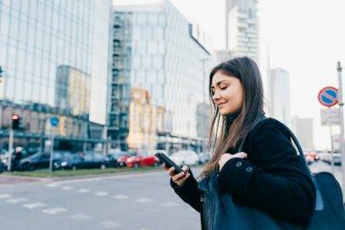 businesswoman outdoor using smartphone