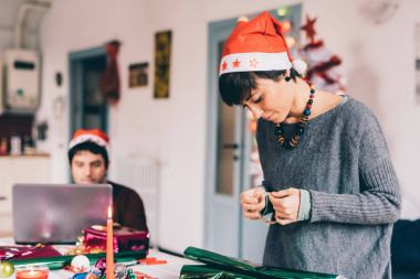 woman wrapping christmas present