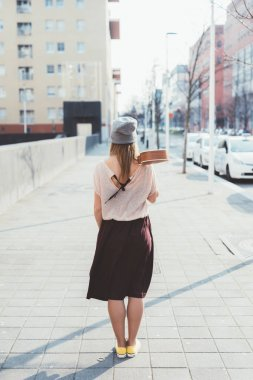 Young beautiful woman walking outdoor in the city