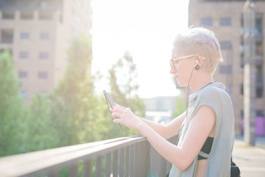 young woman listening music using smartphone