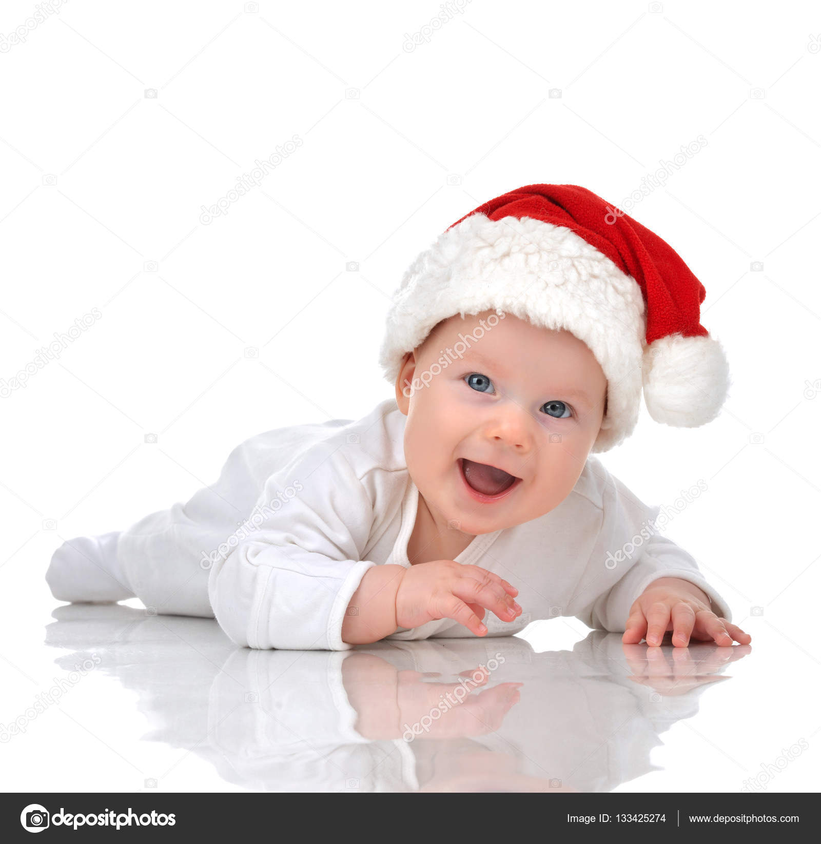 de8694ed830 Infant child baby girl lying in red christmas santa hat happy smiling  isolated on a white background — Photo by dml5050