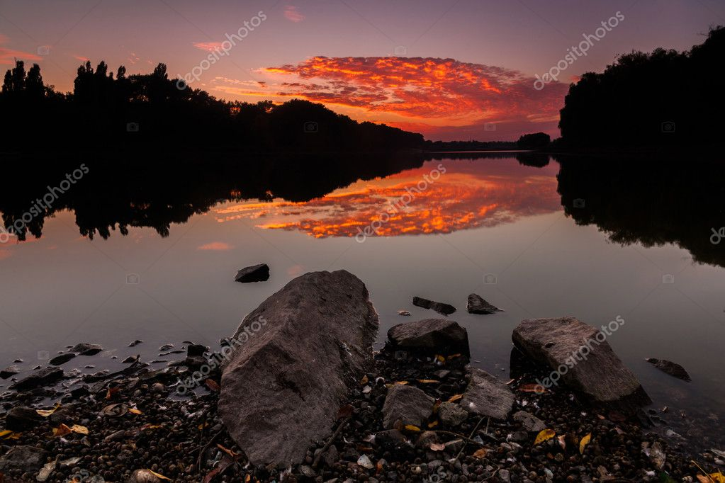 Saturated red sunrise over beautiful lake