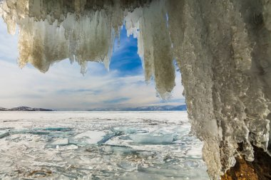 Ice Cave with icicles, winter Lake Baikal. Russia