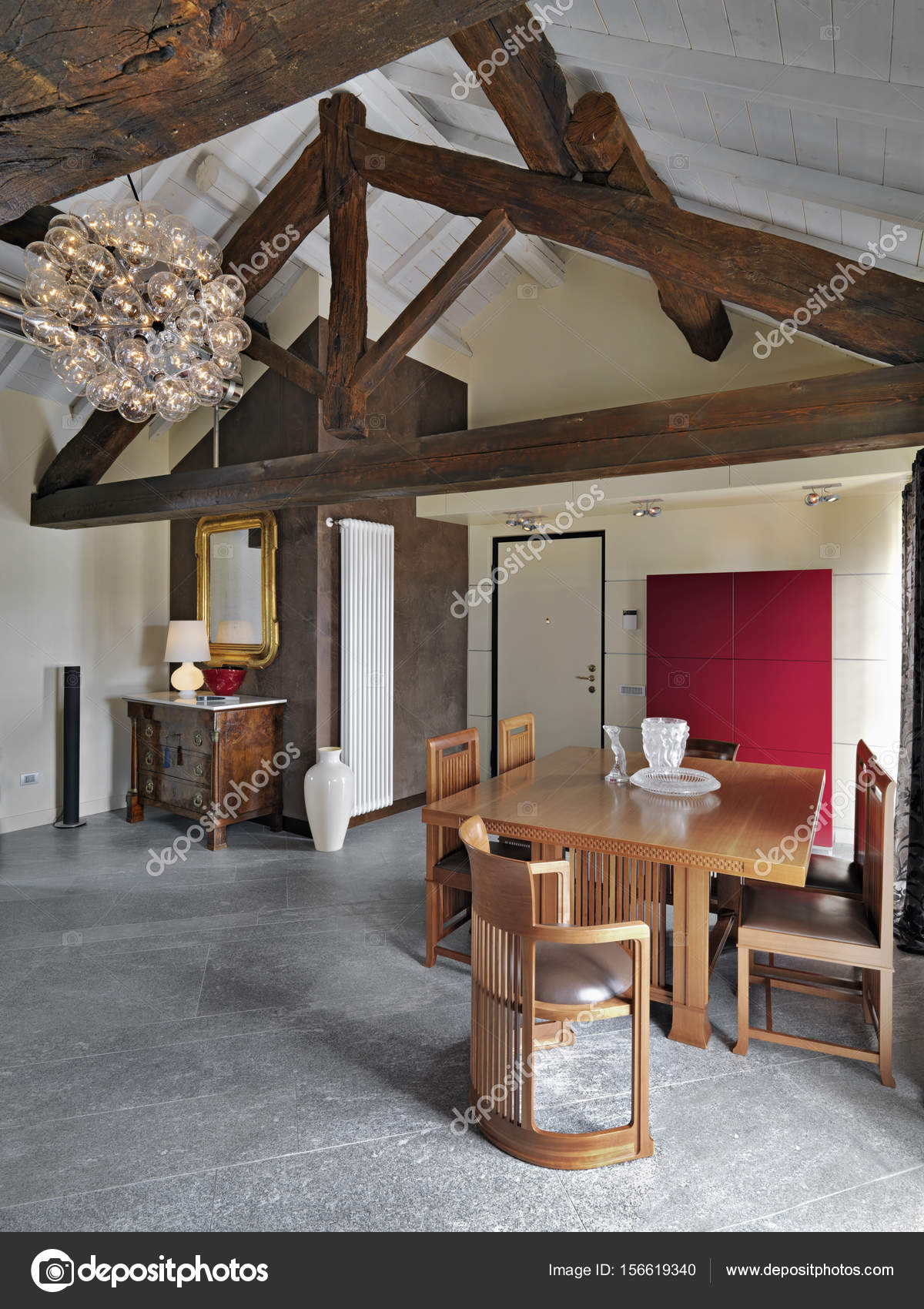 modern dining table near to main door of entrance in the attic room