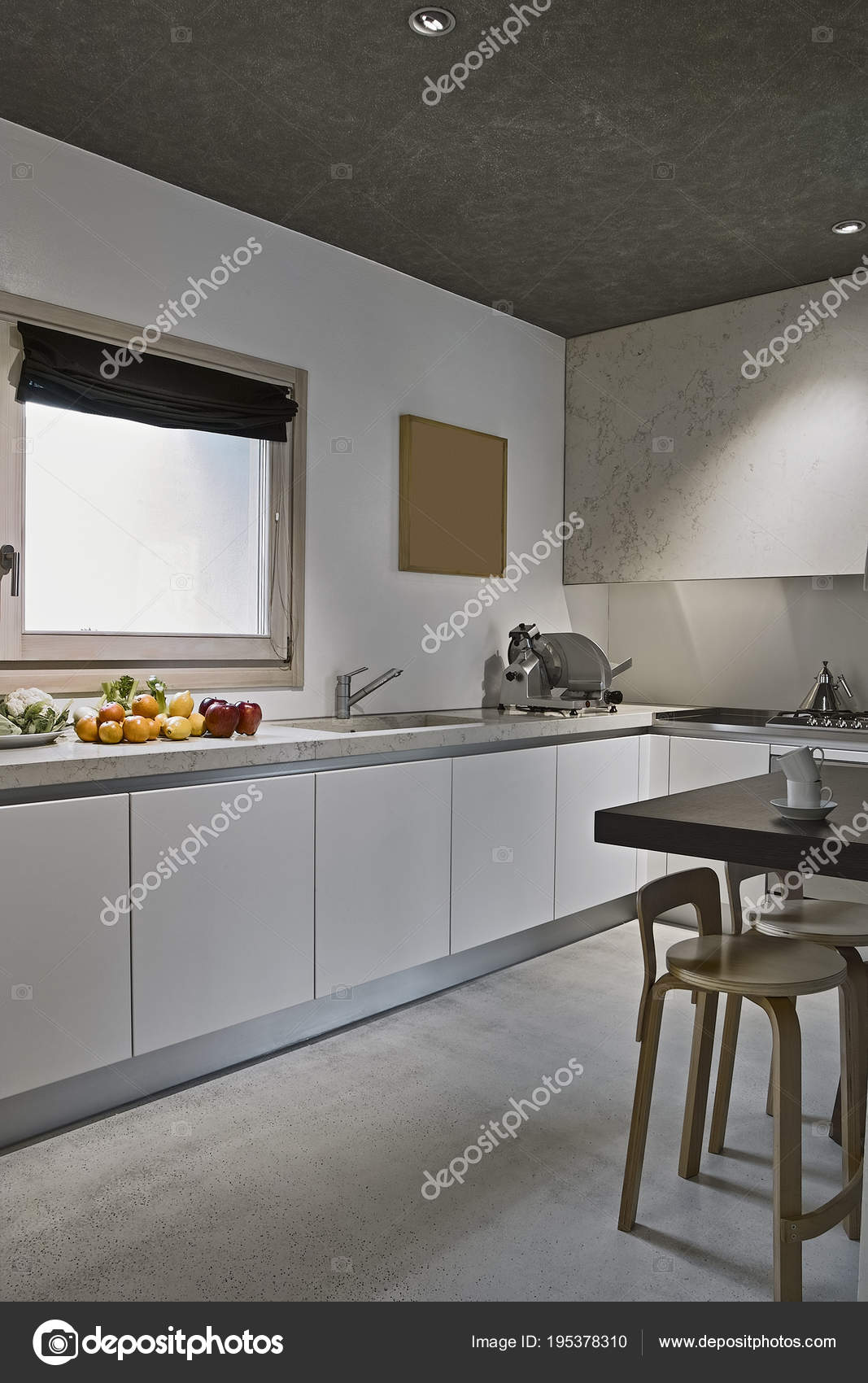 Interiors Shots Of A Modern Kitchen With Fruits Fresh On The Work