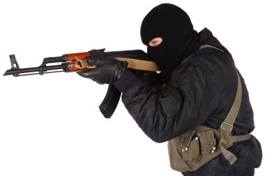 Robber with AK 47 isolated on white background