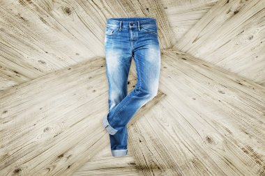 Jeans trouser over white wood planks background