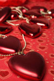 holiday decoration hearts  at red background. studio