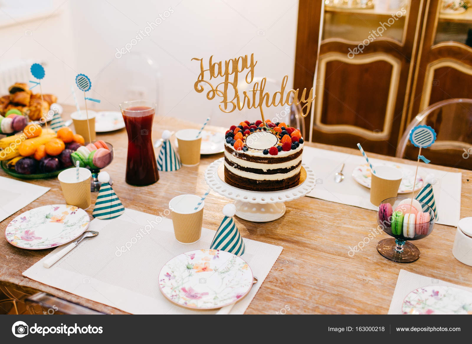 Holiday Table Served Wit Birthday Cake Full Of Fruit Compote Empty Plates And Party Hats Beautiful Set For