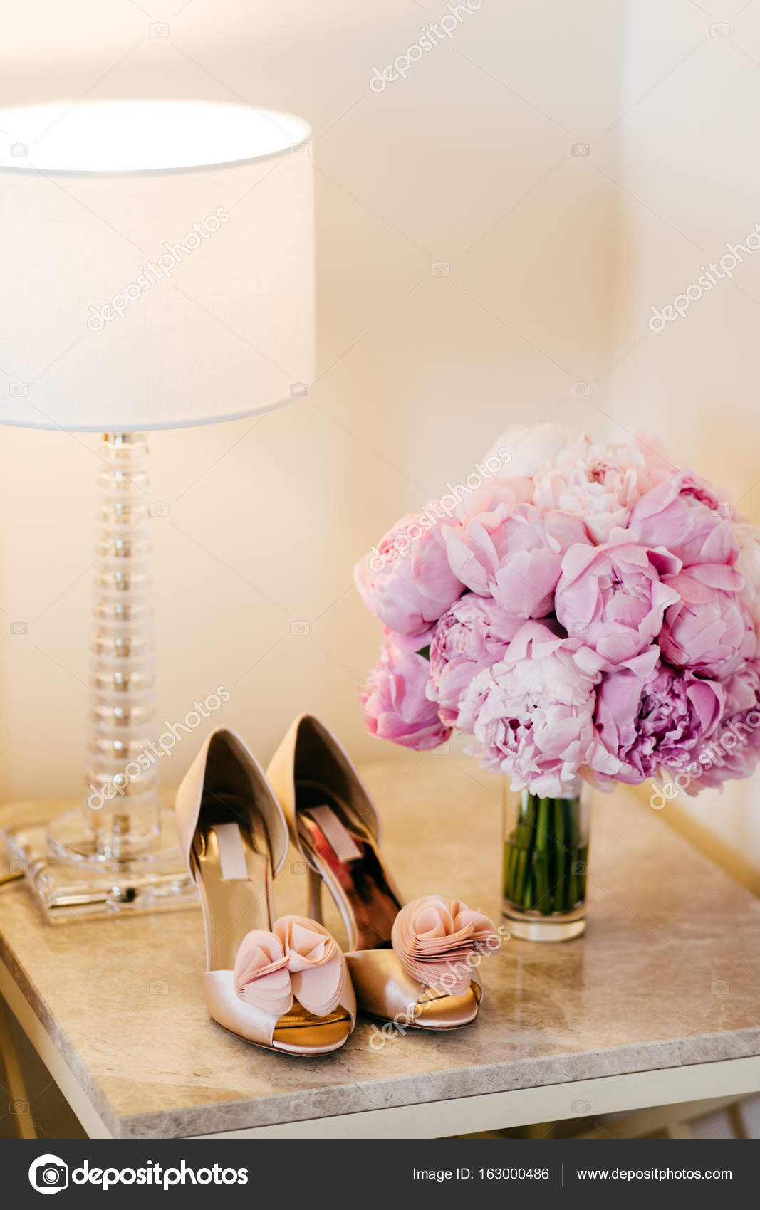 Beautiful Shoes With High Heels Lamp And Bouquet With Pink Flowers