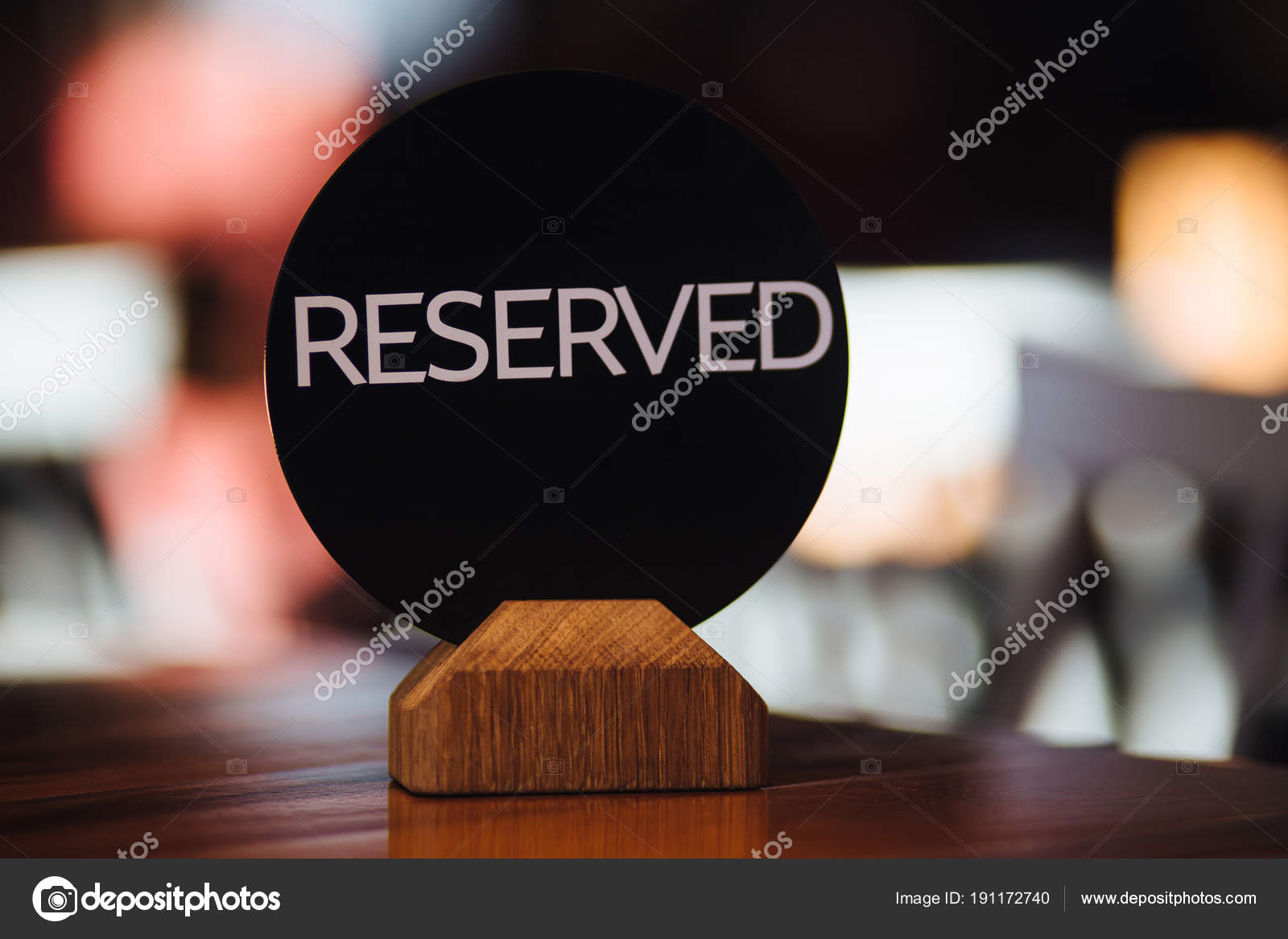 shot of reserved sign on restaurant table stands against blurred