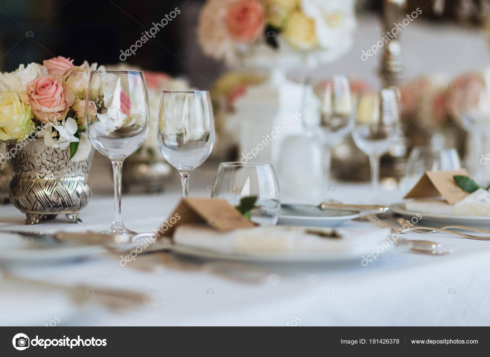Beautiful table served with glassware and cultery, decorated with ...