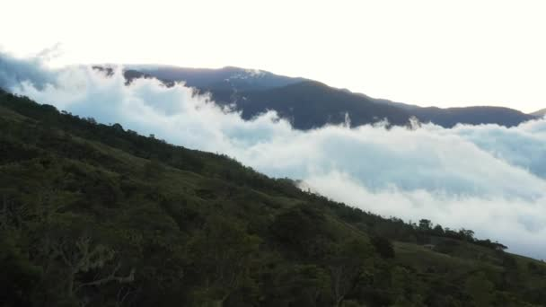 Early morning fog clinging to the mountain range in the rural south of Costa Rica