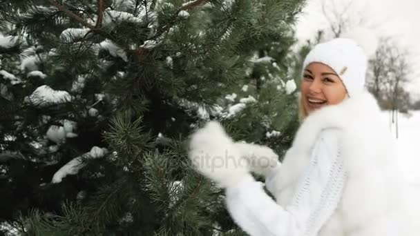 Young beautiful smiling blonde walk in winter forest or park.
