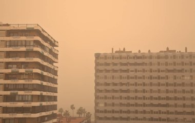LAS PALMAS, SPAIN - February 23, 2020: Health warning and recommendations to stay indoors issued by the autorities as calima, Saharan Air Layer, covers Canary Islands