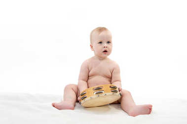 little child baby playing music isolated on white studio shot