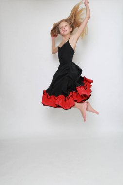 Studio image of flamenco dancer is jumping/Dancer in motion