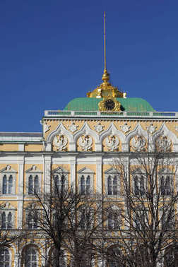 Outdoor view on Kremlin in details from the background of Kremlevskaya embankment at sunny day in early spring.