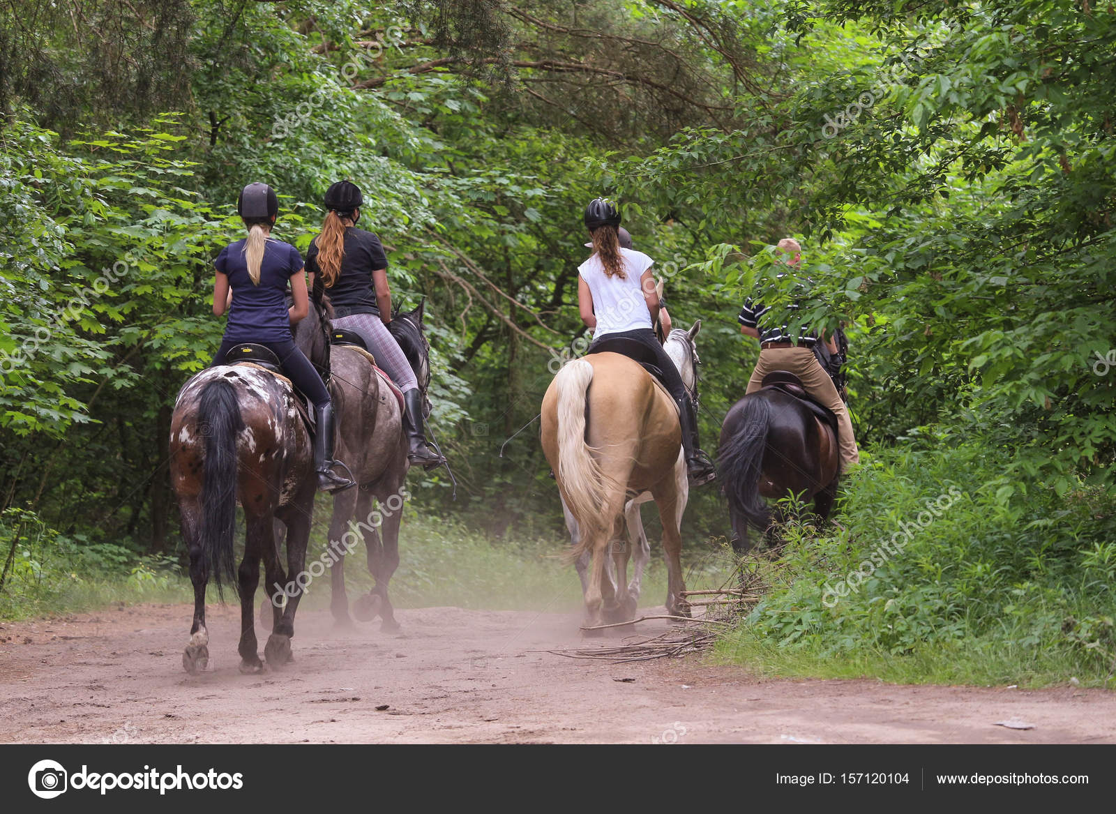 Group Of Friends Riding Horses In The Forest Stock Photo C Wb77 157120104