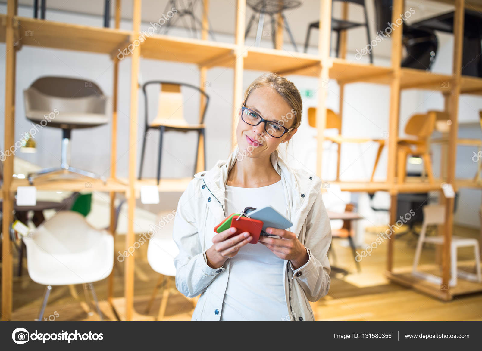 Pretty Young Woman Choosing The Right Material Color Stock Photo