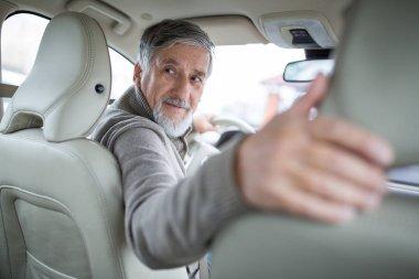 Senior drive driving his modern car