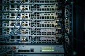 Server rack cluster in a data center (shallow DOF; color toned i