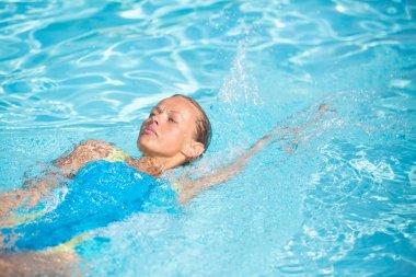 Pretty female swimmer in a poo