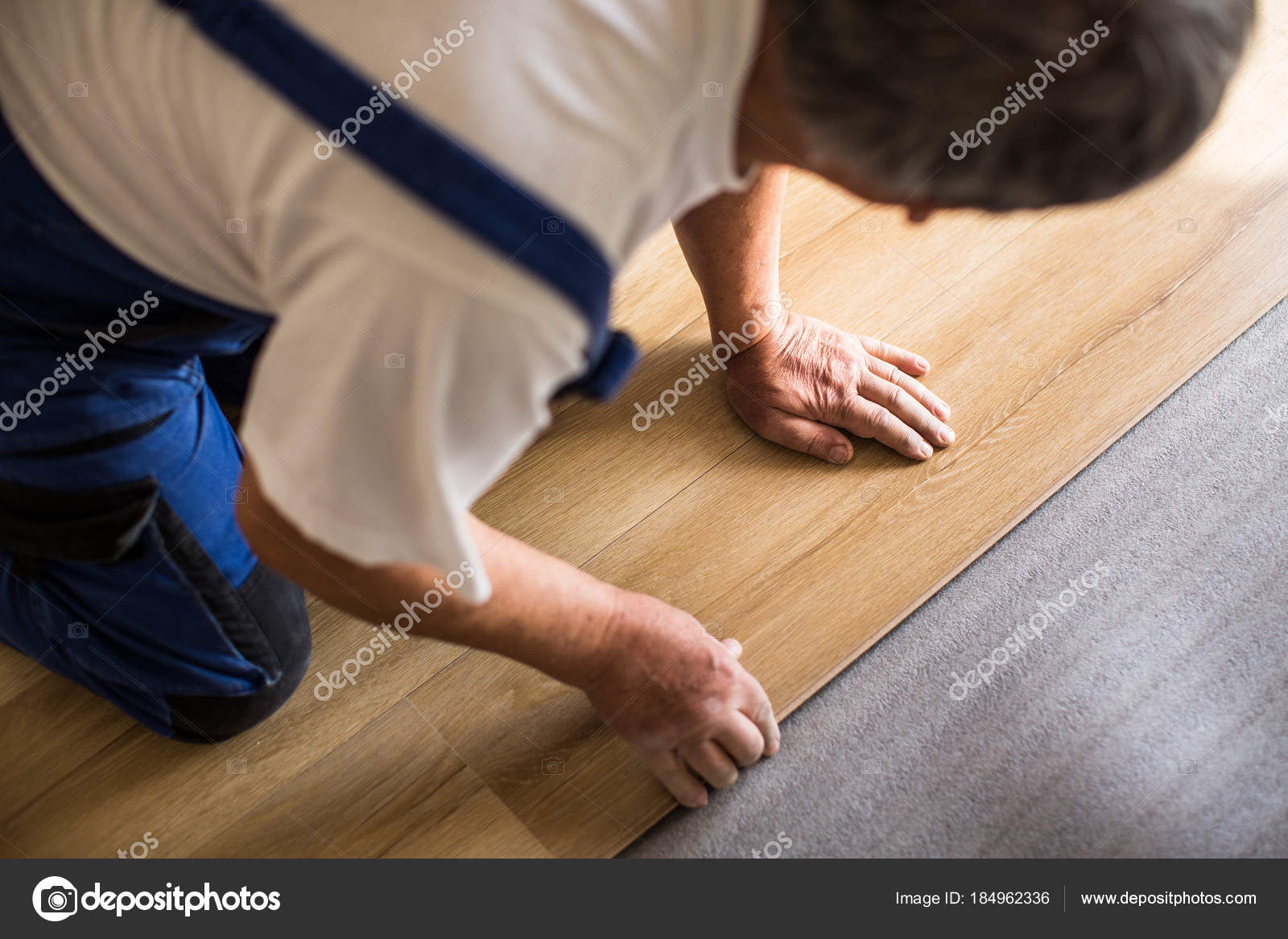 Close Up Of Male Hands Lying Parquet Floor Board Laminate Flooring Stock Photo