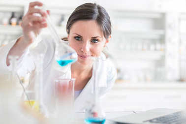 Young, female researcher carrying out experiments in a lab