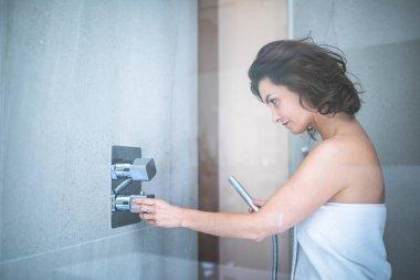 Woman taking a long hot shower washing her hair