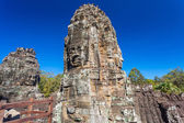Photo Ancient stone faces of Bayon temple