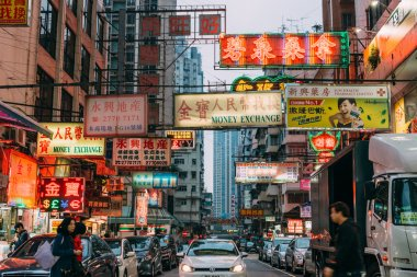 Signs illuminate the night in Kowloon