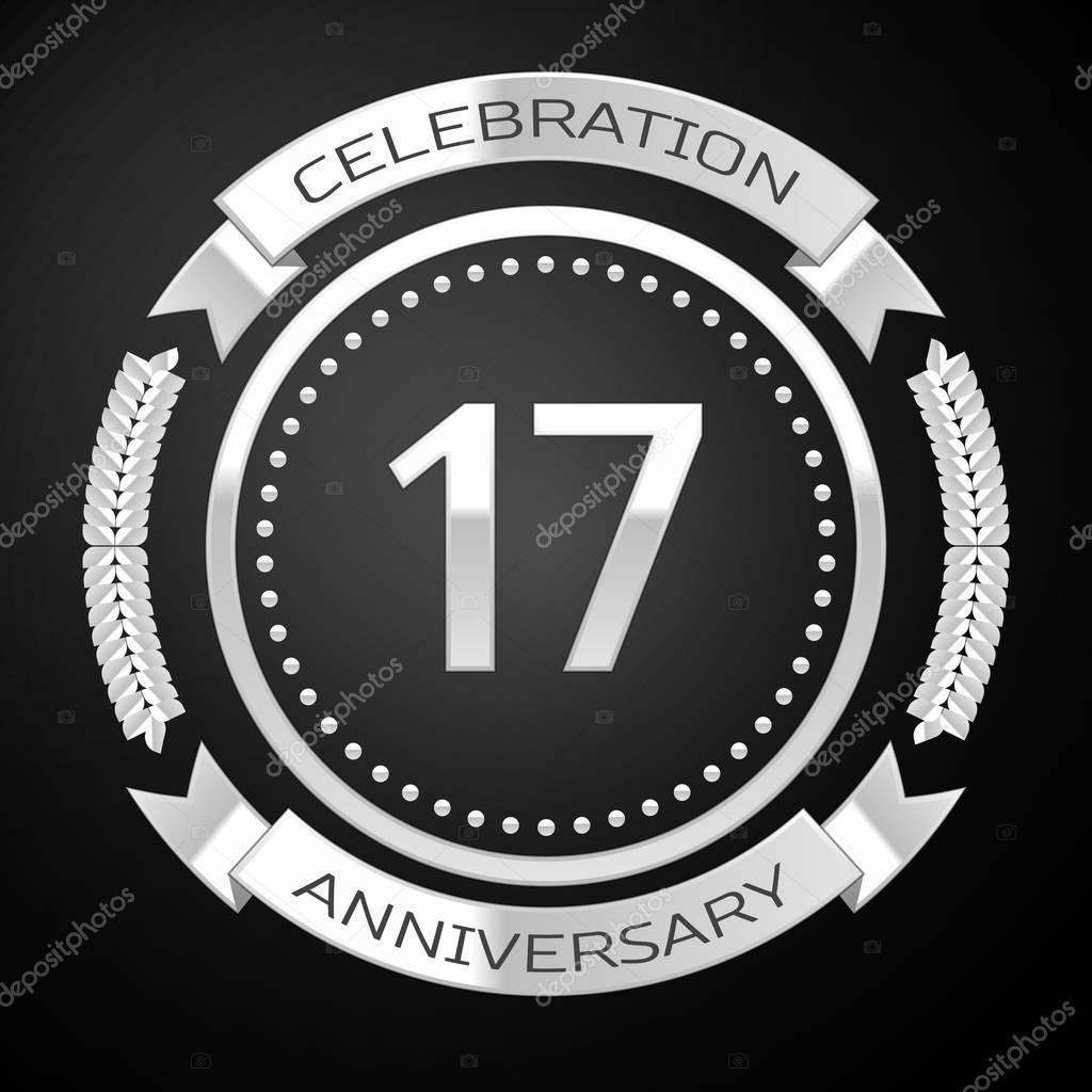 Seventeen years anniversary celebration with silver ring and ribbon on black background. Vector illustration