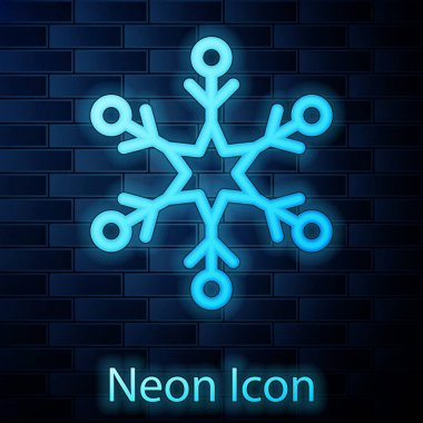 Glowing neon Snowflake icon isolated on brick wall background. Vector Illustration