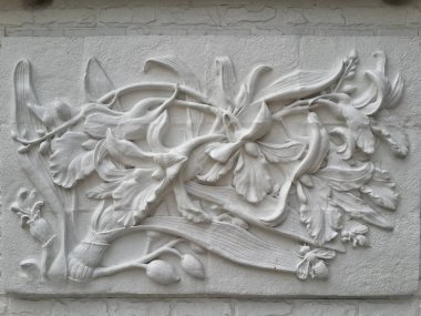 Wall bas-relief stucco in plaster, depicts flowers Lily. Bangkok, Thailand