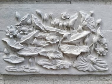 Wall bas-relief stucco in plaster, depicts Lotus flowers. Bangkok, Thailand