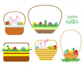 Fotografie Easter baskets with Easter eggs, carrots and bunnies isolated on white background.