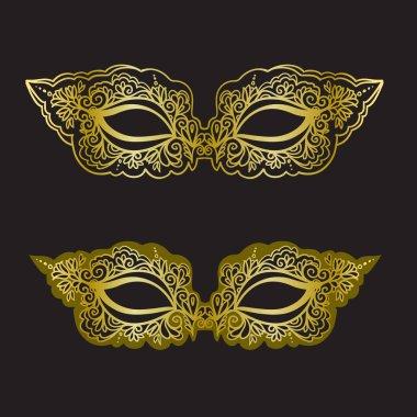 Golden carnival mask on the black background. Beautiful lace mask. Vector illustration