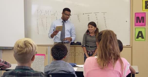 Schoolgirl And Teacher At Front Of Class Stock Video