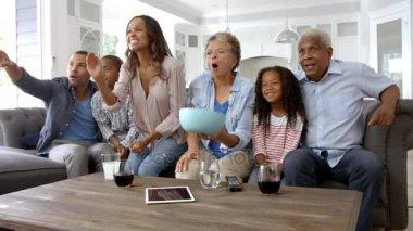 family watching tv. family group at home watchingtv \u2014 stock video #134342136 watching tv m
