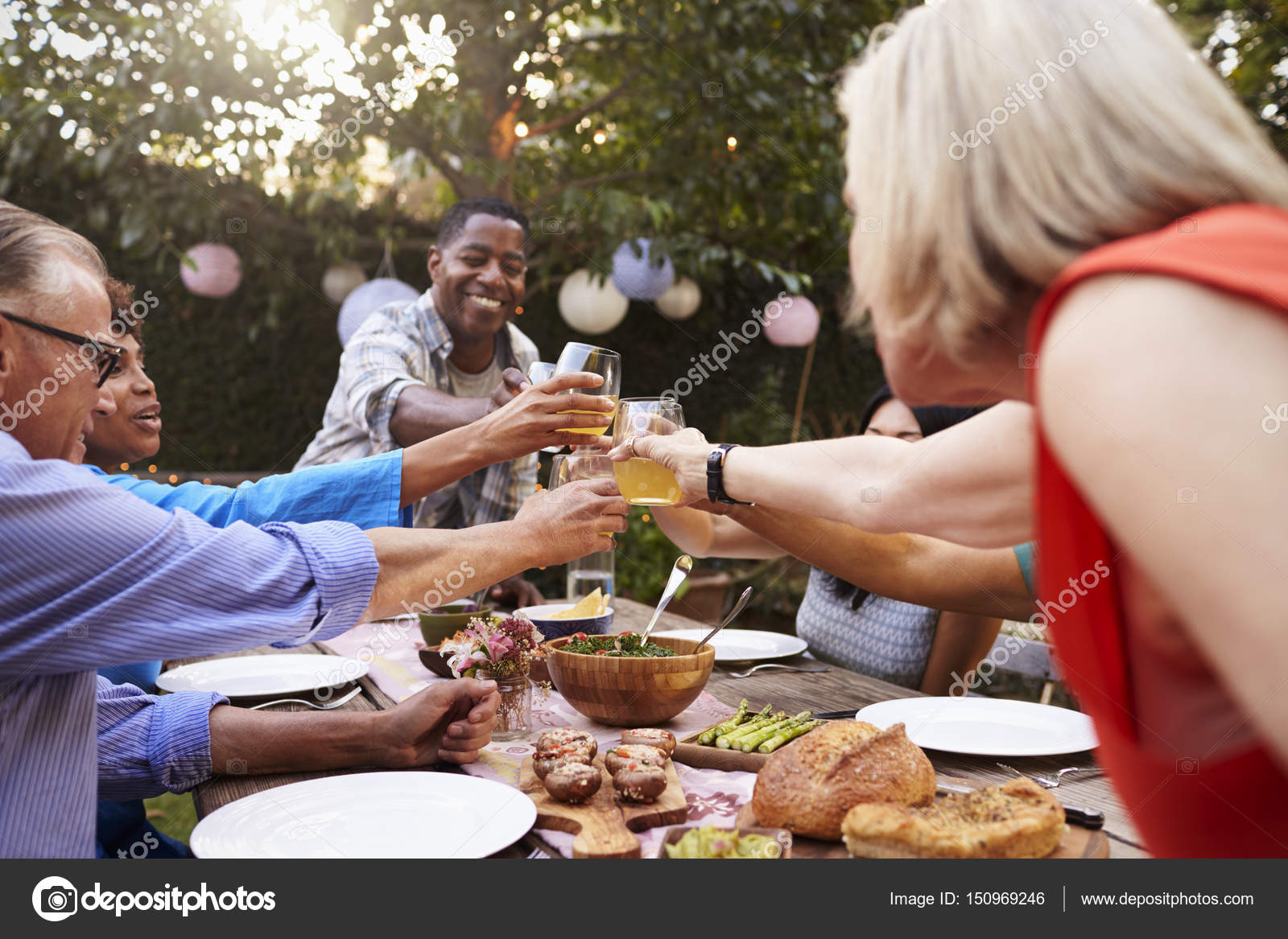 mature friends enjoying outdoor meal — stock photo © monkeybusiness