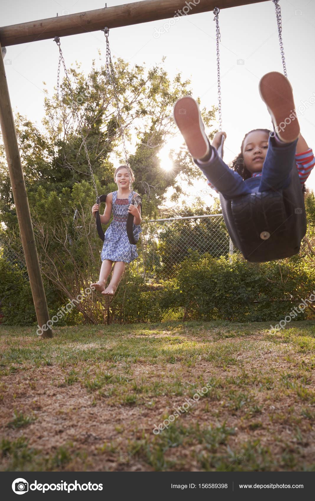 Girls Playing On Garden Swings — Stock Photo © monkeybusiness #156589398