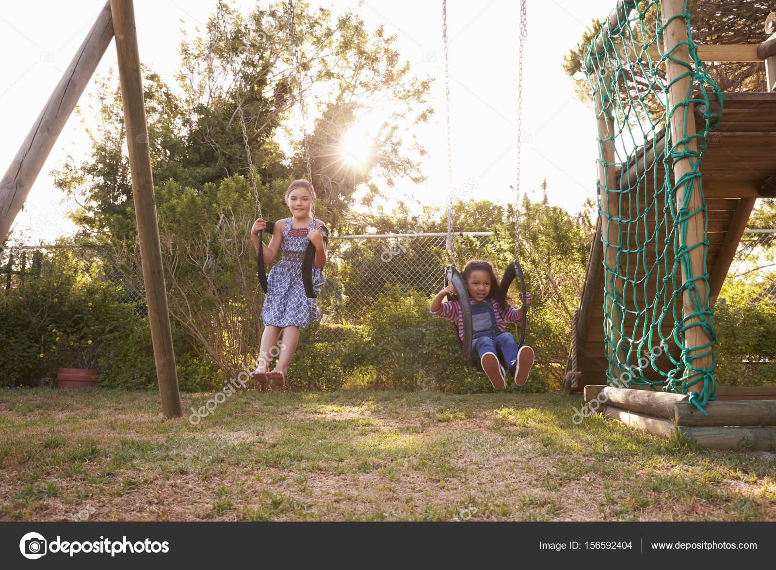 Girls Playing On Garden Swings — Stock Photo © monkeybusiness #156592404