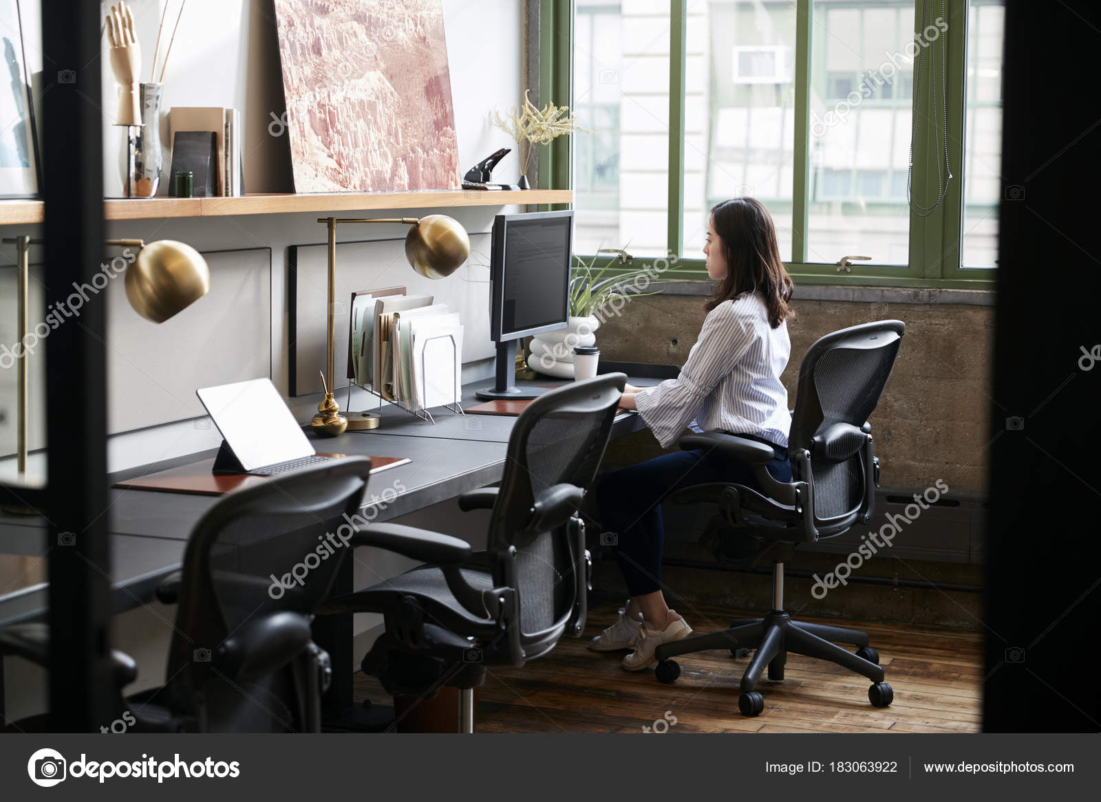 compact office. Young Woman Working Alone Compact Office \u2014 Stock Photo E