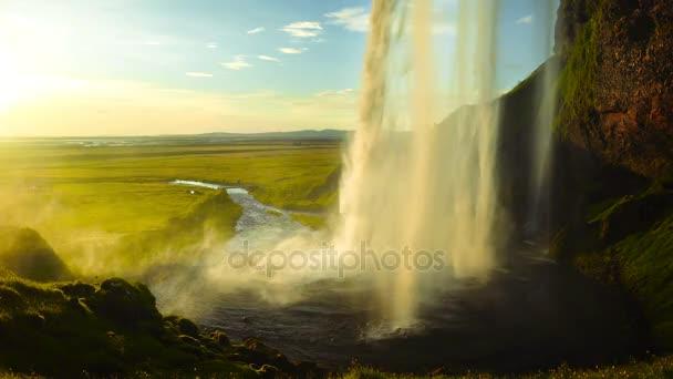 Seljalandsfoss vodopád při západu slunce, Island