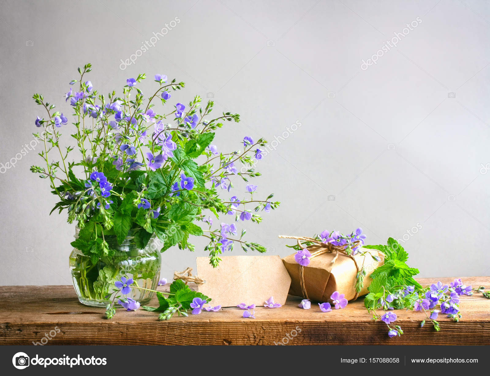 Bouquet Of Small Delicate Blue Flowers Veronica And Gift Box Stock Photo